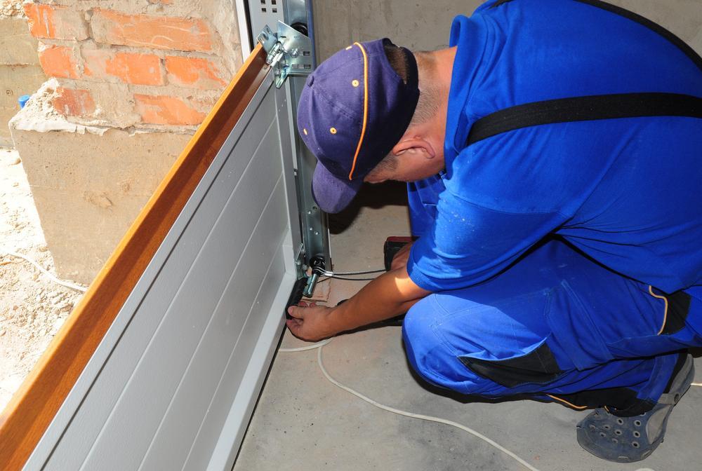contractor installing new garage door