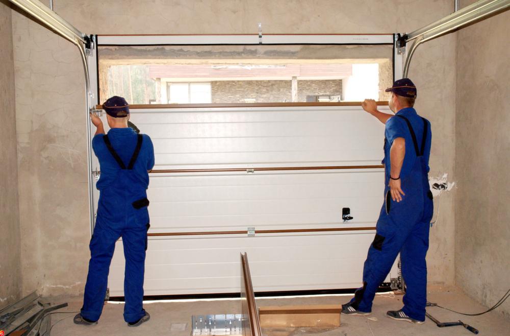 contractors working on garage door installation